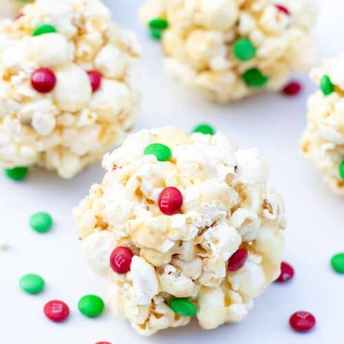 It's a childhood favorite! These Christmas inspired Easy Classic Popcorn Balls are a super fun treat to make for the holidays!