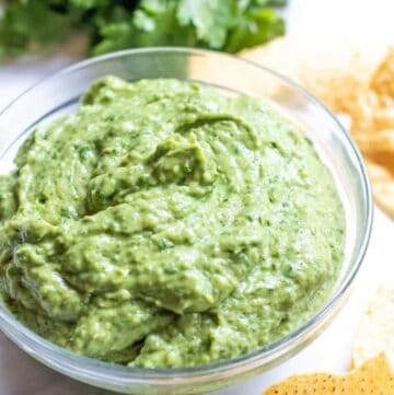 This Fresh Spinach Guacamole takes your classic guacamole and makes it even healthier by adding some fresh spinach but keeping the classic guac flavors!