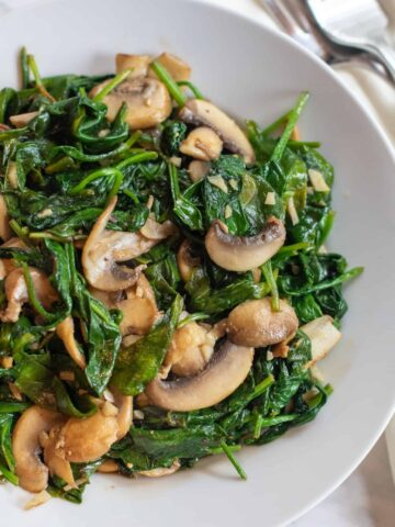 a bowl of sauteed spinach and mushrooms