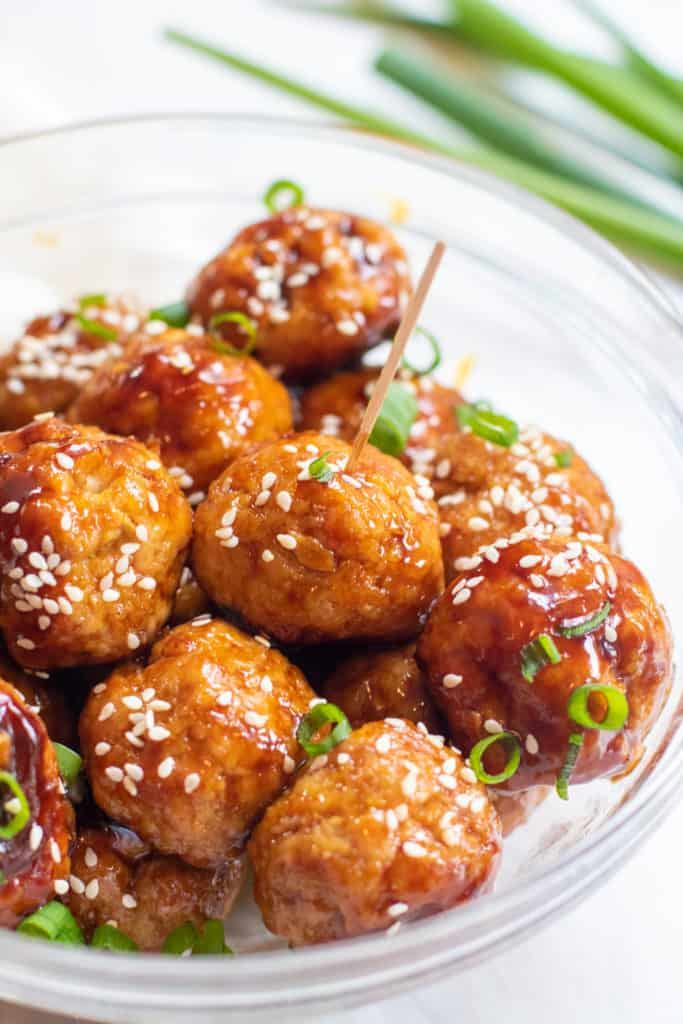 These Sweet Sesame Ginger Meatballs are an Asian style turkey meatball that can be served as an appetizer or on a bed of rice for a complete meal! #meatballs #recipe #easy #turkey #sesameginger