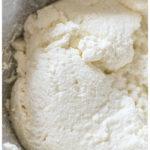 fresh made ricotta cheese in a cheese cloth