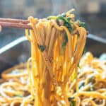 beef and spinach noodles in chopsticks