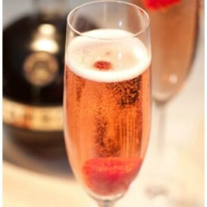 a champagne flute with a pink bubbly drink and a raspberry.