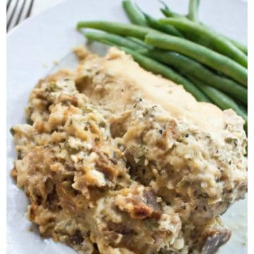 cooked stuffing and chicken and green beans on a plate