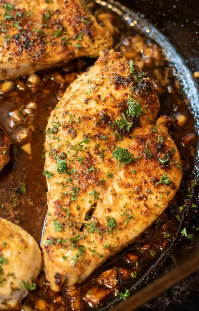 cooked garlic butter chicken breasts in pan