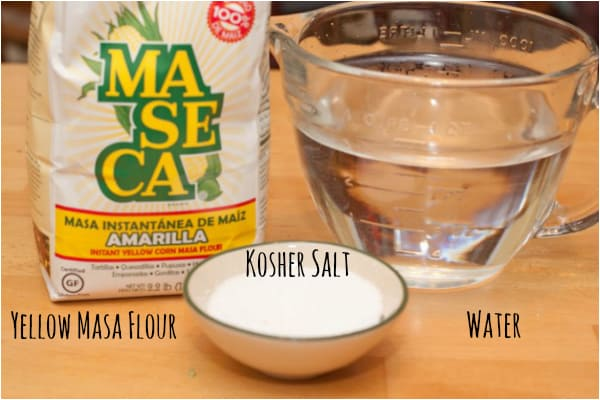 masa flour, kosher salt, and water on the counter