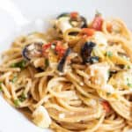 greek pasta with olive and tomatoes and feta cheesein a bowl