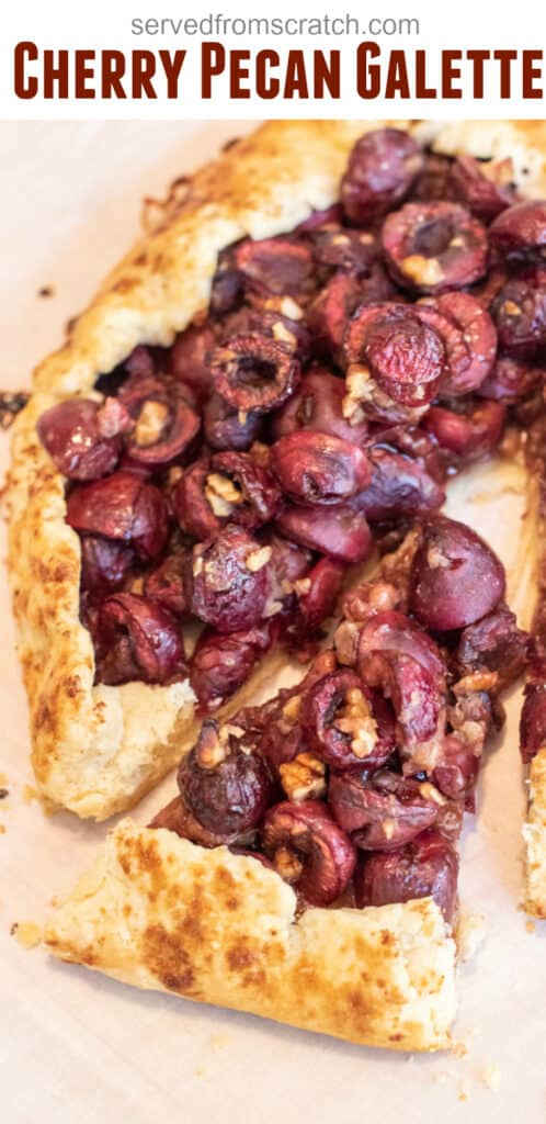 close up of a baked cherry galette with a slice out