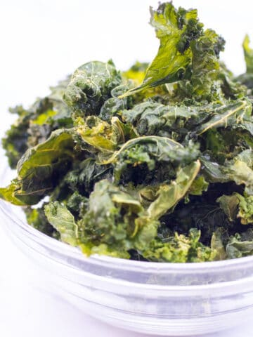 a bowl filled with crispy kale chips