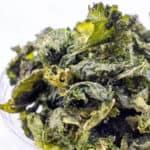 a bowl of crispy kale chips.