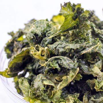 a bowl of crispy kale chips.
