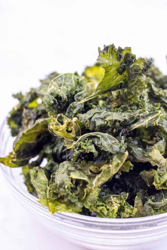 a bowl of crispy kale chips