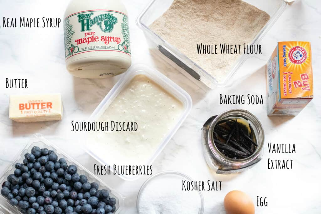 ingredients for sourdough blueberry muffins on a counter