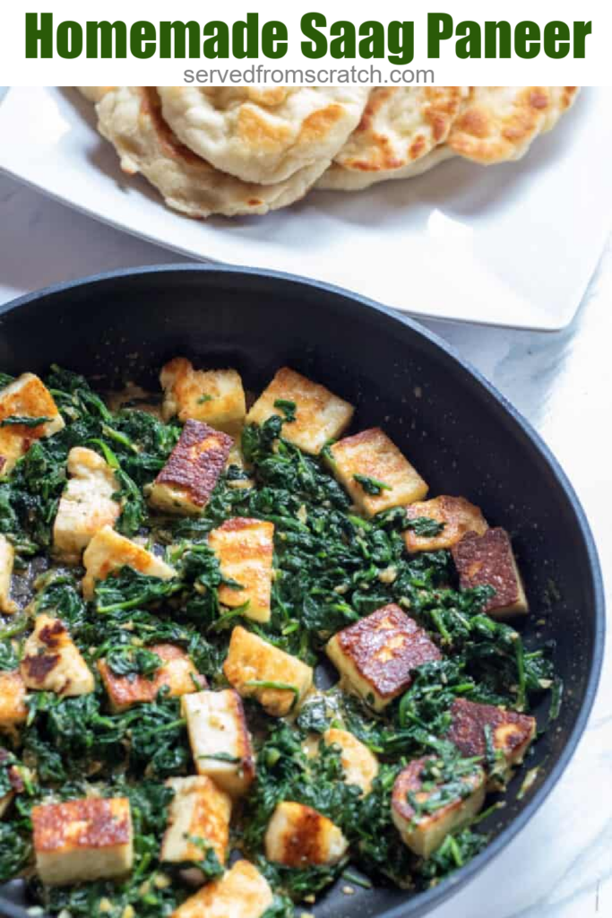 spinach in a pan with seared paneer..