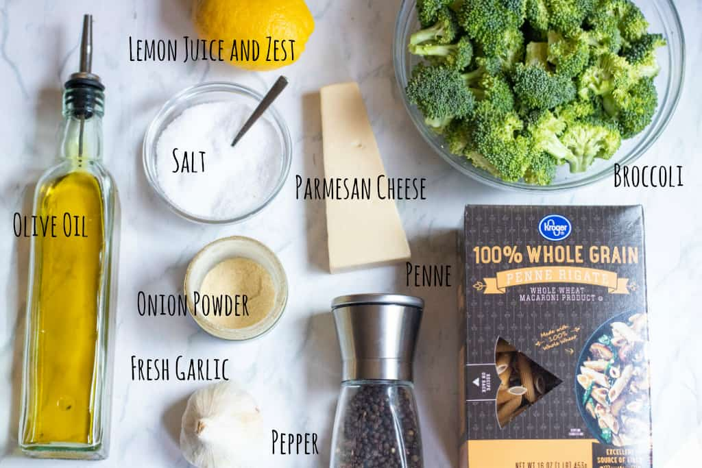 ingredients for broccoli penne on a counter