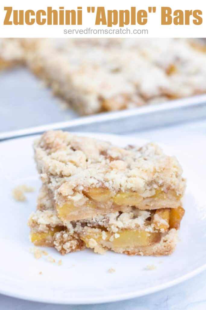 a plate of two stacked zucchini bars on a plate with Pinterest pin text.