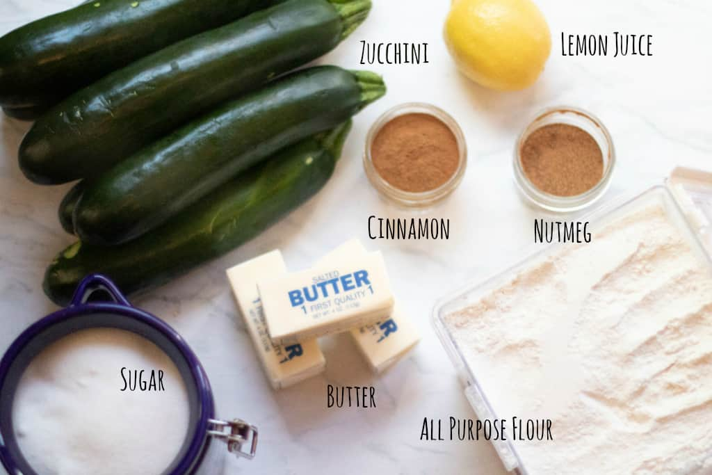 zucchinis, butter, sugar, cinnamon, flour, nutmeg, and lemon
