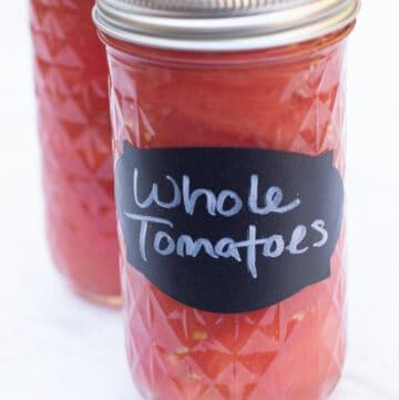 2 mason jars of whole tomatoes.
