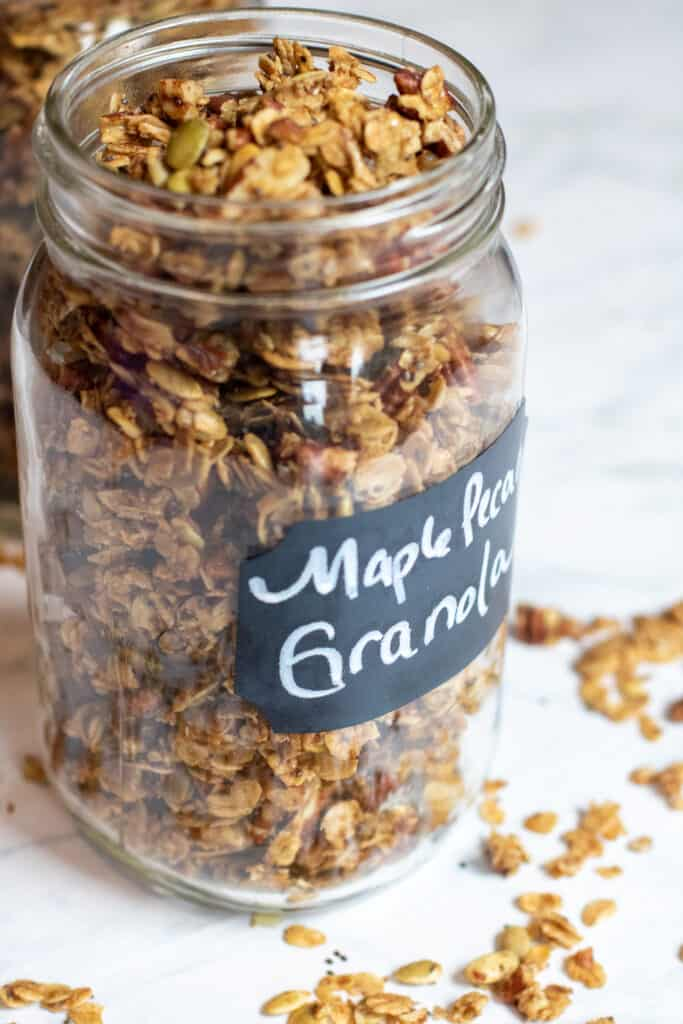 a close up of a large mason jar of granola