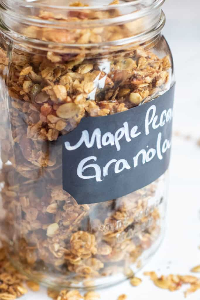 a close up of a mason jar of granola