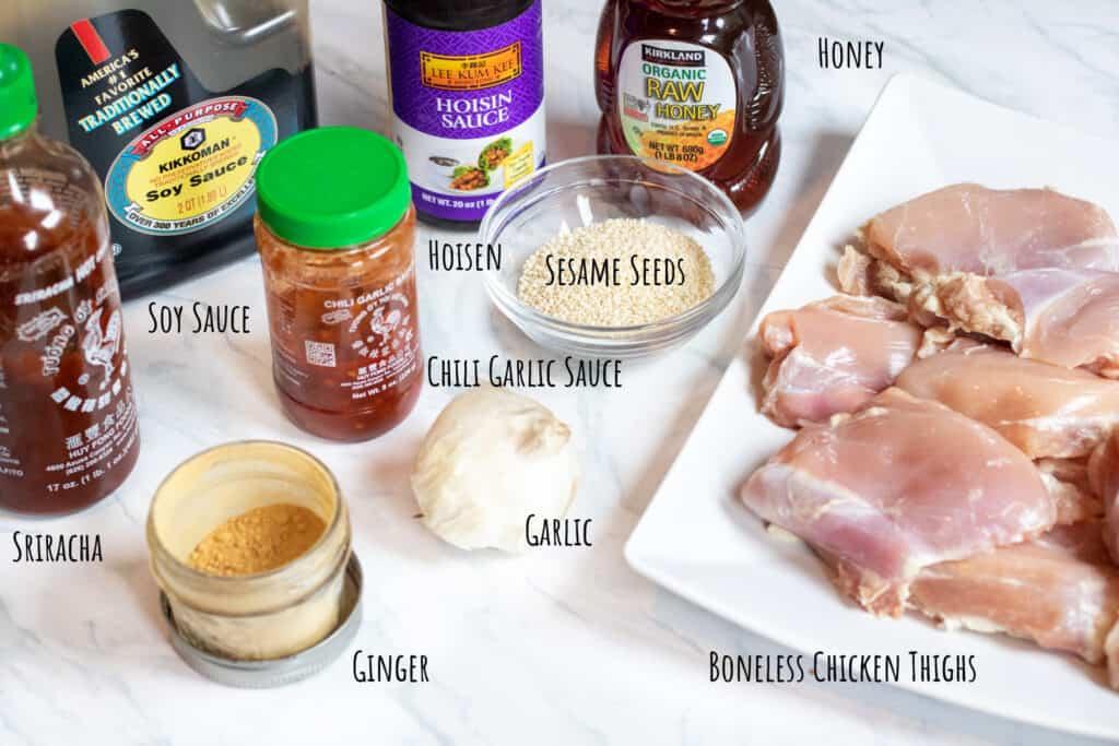 soy, sriracha, ginger, garlic, chili garlic sauce, sesame seeds, honey, hoisin and raw chicken thighs