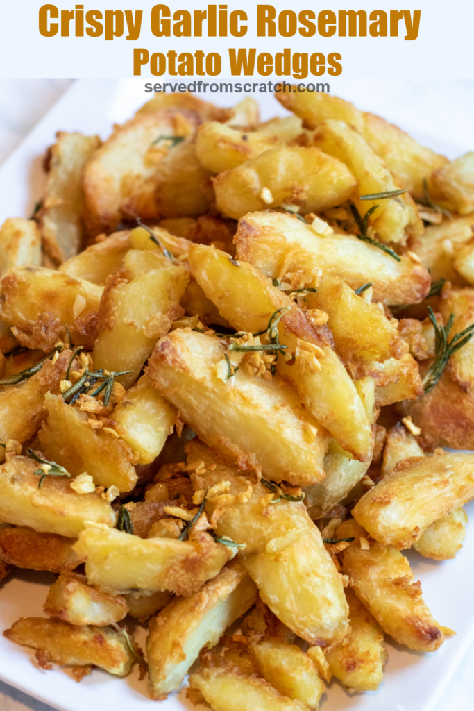 a plate of wedges of potatoes crisped with rosemary and garlic with Pinterest pin text.