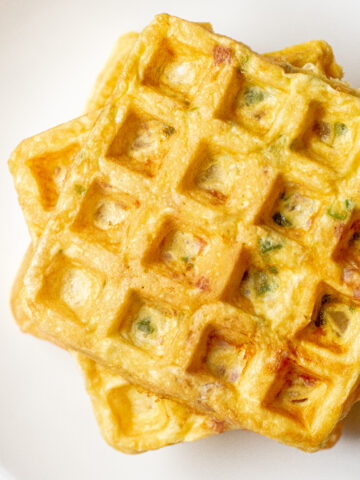 an overhead of stacked egg waffles.