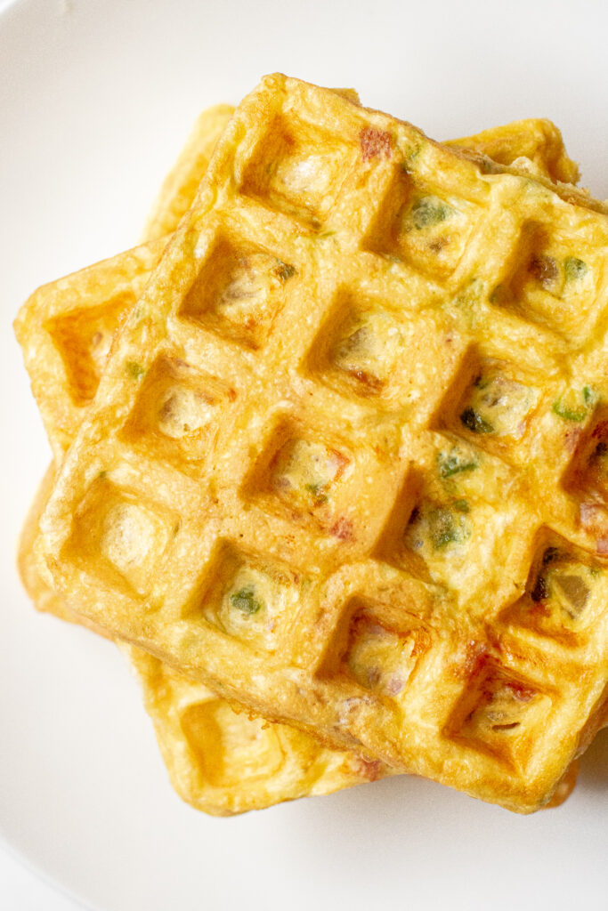 an overhead of stacked egg waffles