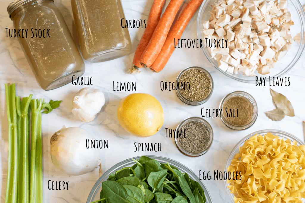 stock, celery, onion, ,lemon, spinach, noodles, cubed turkey, oregano, thyme, celery salt, carrots