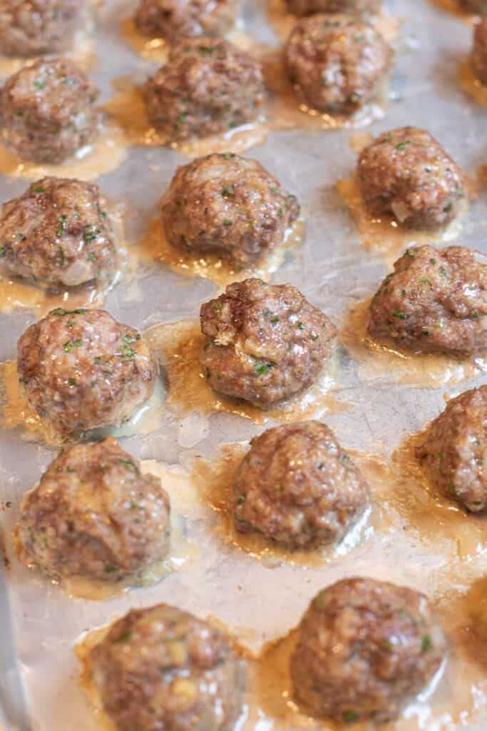 cooked meatballs on a baking sheet