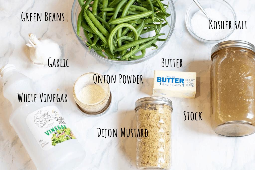 green beans, garlic, onion powder, vinegar, mustard, butter, stock, and salt