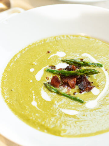 bowl of soup with bacon and asparagus and cream