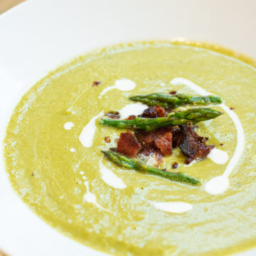 bowl of soup with bacon and asparagus and cream.