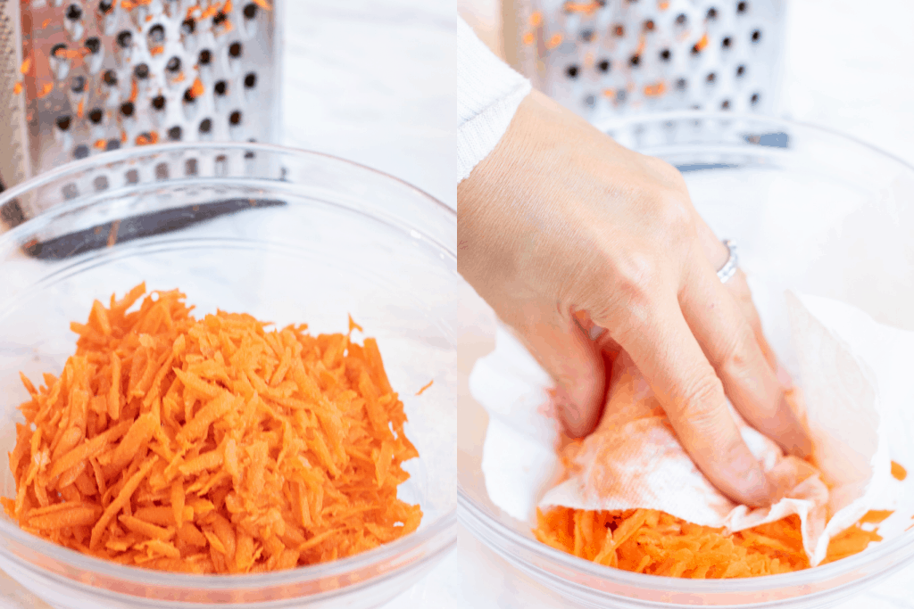 shredded carrots in a bowl and a hand with a paper towel on them