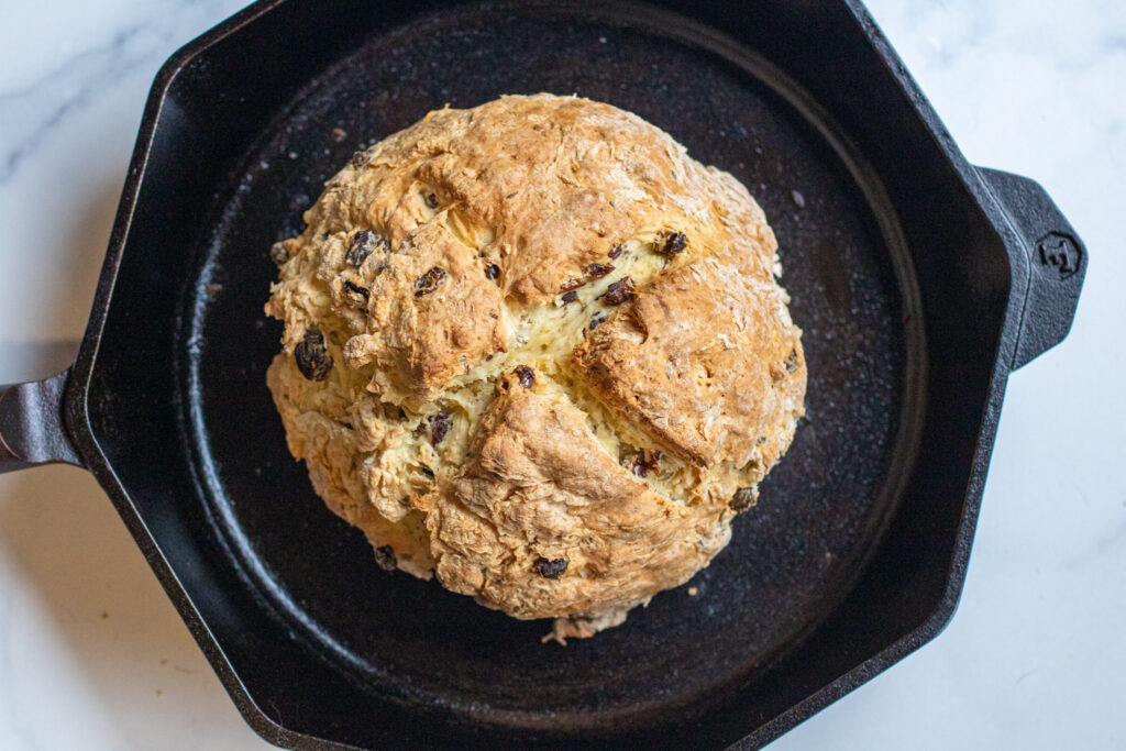 baked bred with raisins in a cast iron skillet