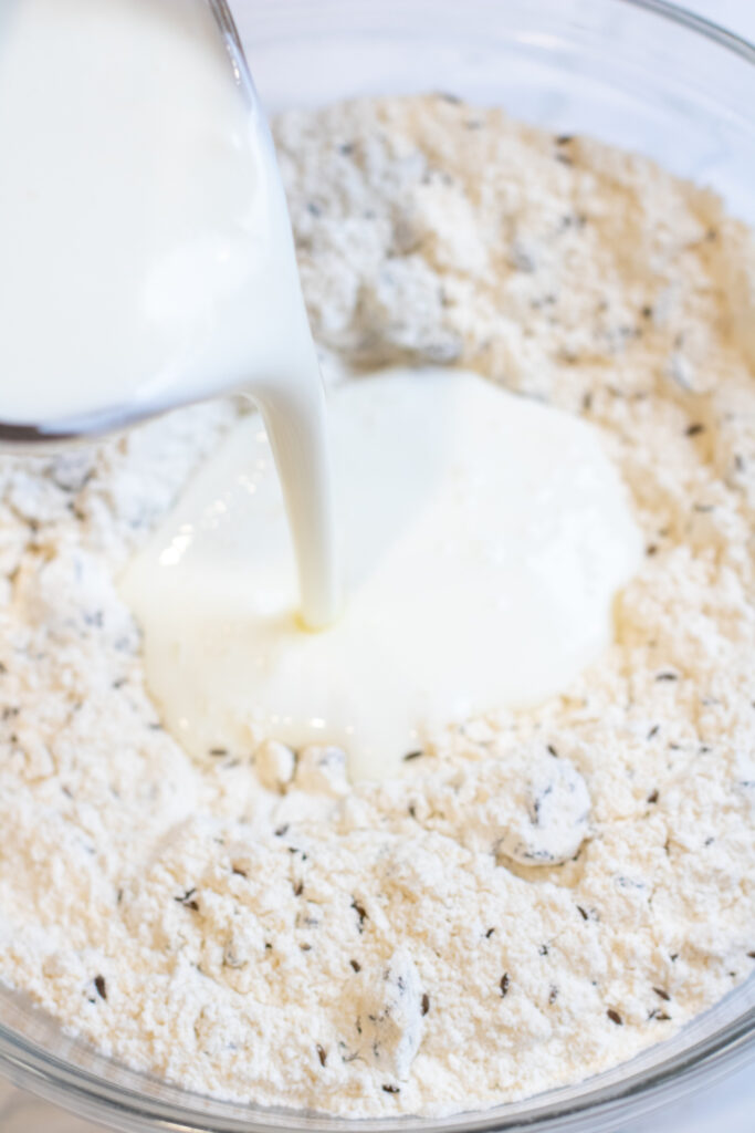 a bowl of butter with buttermilk being added