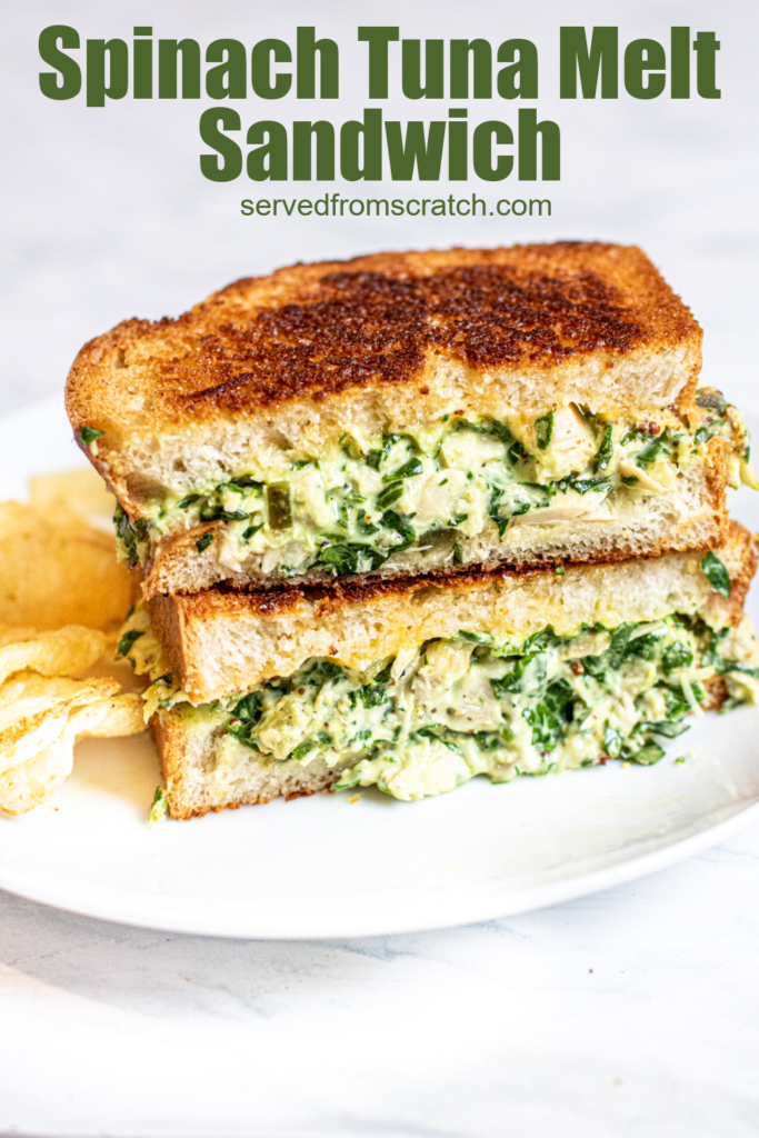 stacked tuna melt with spinach on a plate with chips with Pinterest pin text.