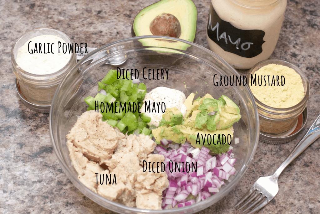 a bowl of mayo, tuna, onion, avocado, celery