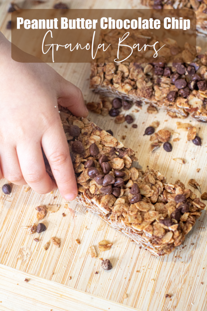 a kids hand grabbing a chocolate chip granola bar and pinterest text.