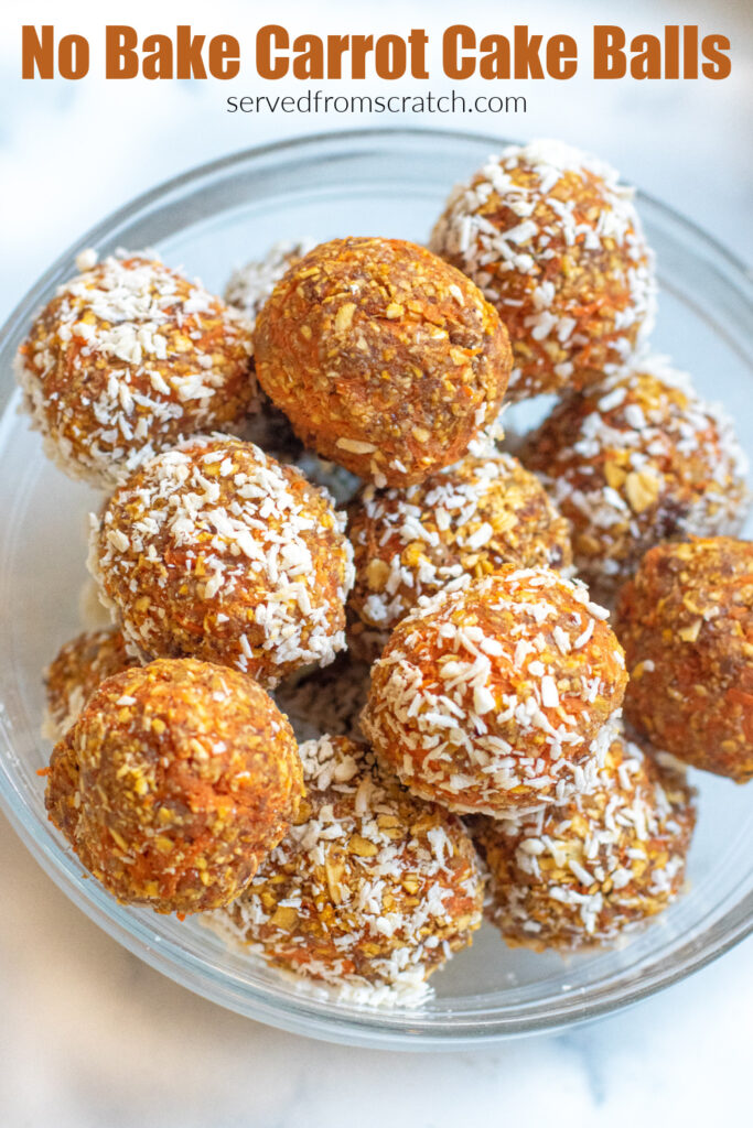 a bowl of balls of oats and carrots with some coated with coconut and some not with Pinterest pin text.