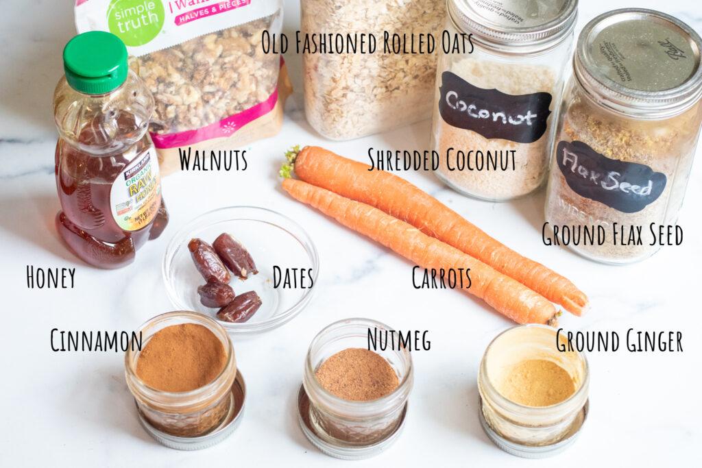 honey, walnuts, oats, coconut, flax, carrots, dates, cinnamon, nutmeg, ginger on counter.