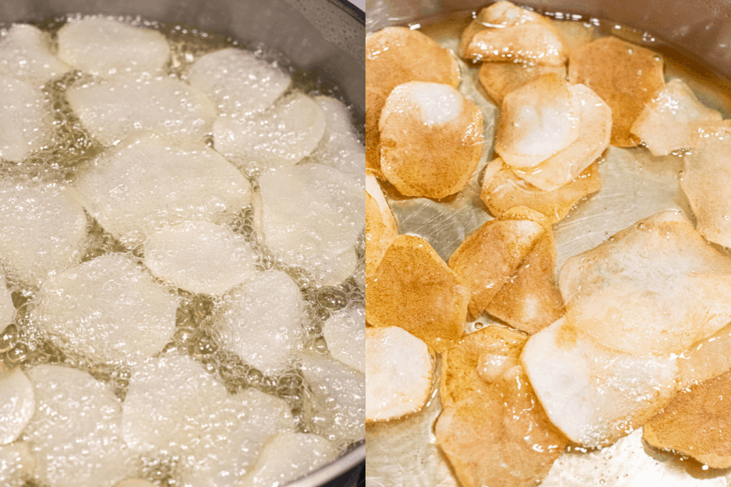 sliced potatoes being fried in oil and then starting to brown in oil.