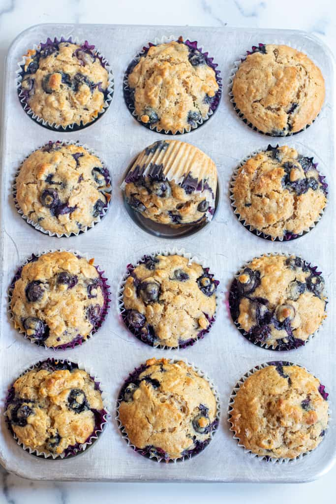 blueberry muffins in a tin.