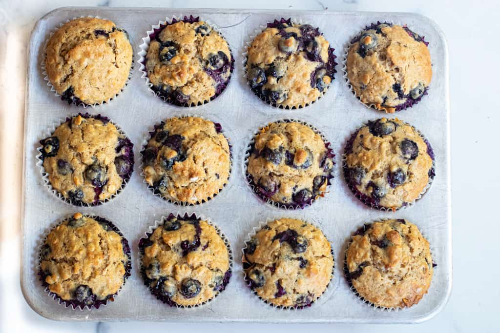 baked blueberry muffins in a tin.