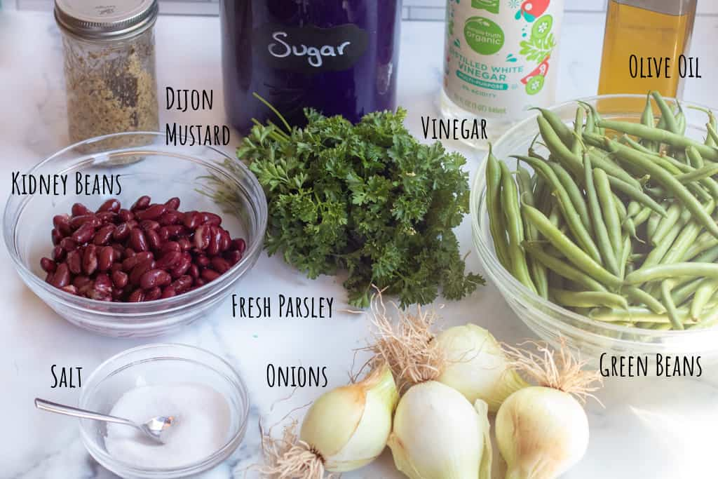 dijon mustard, sugar, vinegar, oil, beans, parsley, green beans, salt, onions.