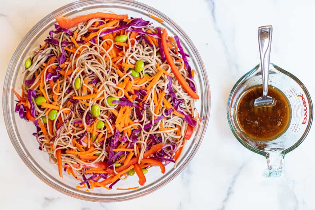 mixed soba noodle salad with dressing in a pyrek.