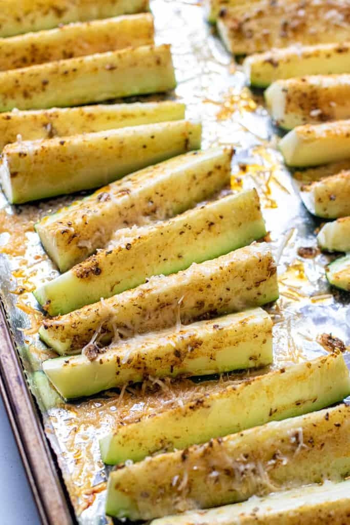 baked zucchini spears on aluminon foil.