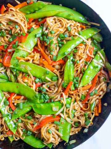 a pan with cooked veggies and noodles.