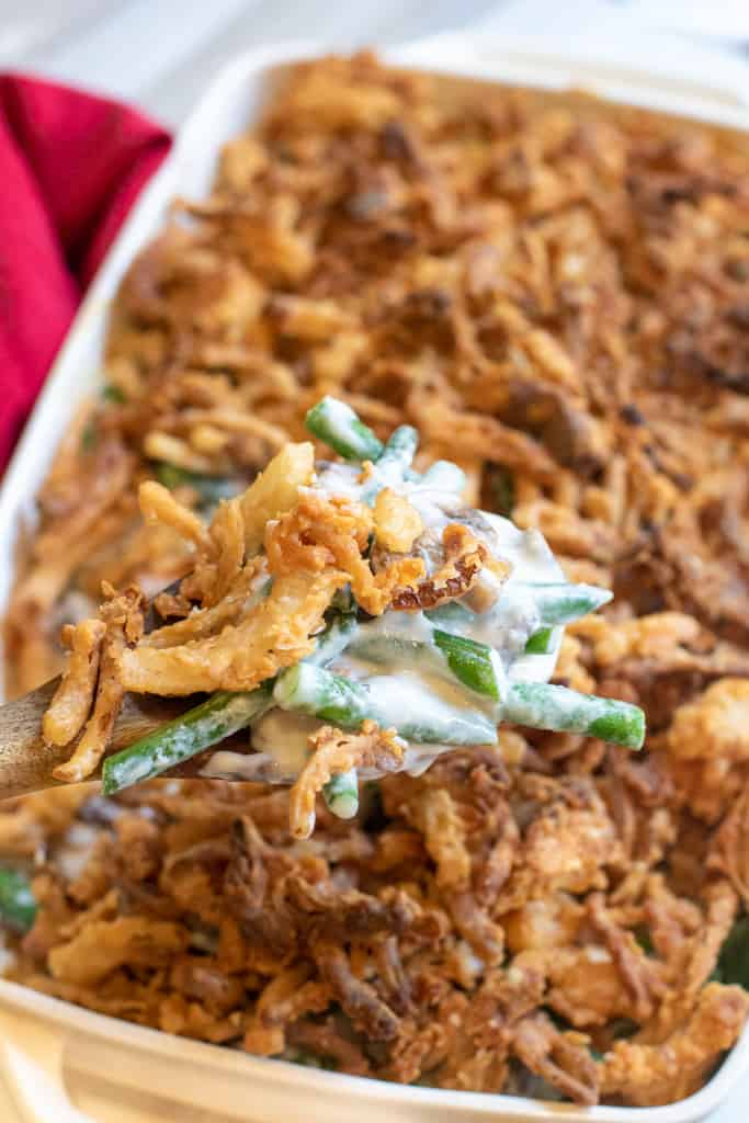 green bean casserole with a spoon scooping some out.