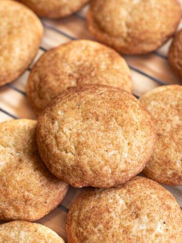 cooling rack of big snickerdoodle cookies.